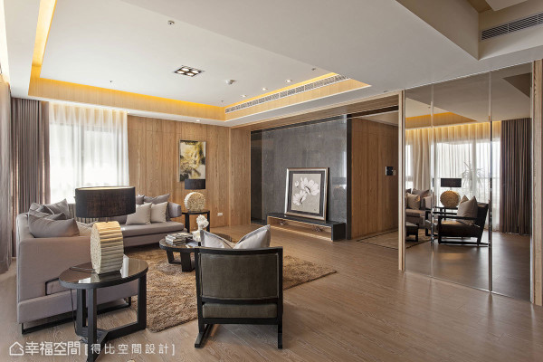 玄关与客厅之间的斗框造型,转化场域过渡之余,也延伸、放大电视主墙面的既有尺度。