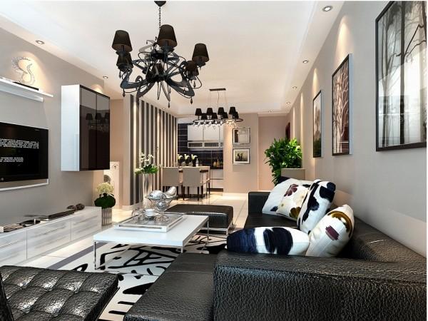 案在总体上呈现多元化,兼容并蓄的状况。室内布置是以黑白色家具为主。客厅的电视背景墙两边是以黑白烤漆组合柜做了一个简单而又美观的造型,墙体是以浅咖色乳胶漆为整体,电视柜是以白色烤漆组成。