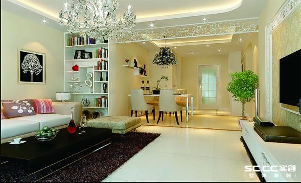 设计师通过一进门大气的餐厅设计带园型的餐桌,地面运用和餐桌一体的拼花体现整体。