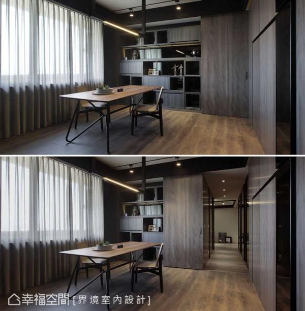 书柜旁的隐藏门,是进入主卧的入口,用相同的木质,让空间具有整体一致性。