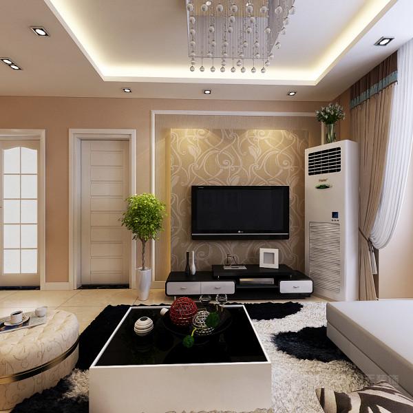 客厅的电视背景墙是以石膏线圈边中间加以一圈壁纸中间是凸起的石膏板加以壁纸石膏板四周是灯带做了一个简单而又美观的造型。