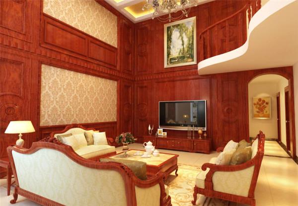 此案例定位为简欧风格,与中国传统风格一样,也用了对称的方式来体现欧式的庄重与大气。客厅的电视背景墙采用欧式元素造型,桃花心木面板饰面,古典雕花,搭配贵族金色壁纸,塑造尊贵又不失高雅的居住空间