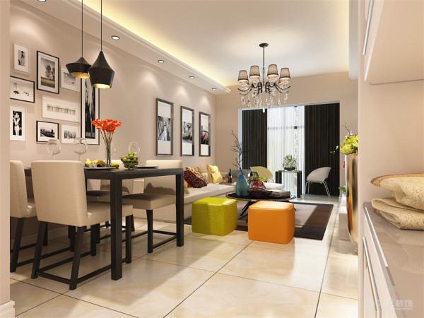 客厅设计采用简约明朗的线条,将空间进行了合理的分隔。整体颜色以简洁的咖色为背景,只有沙发组合几个大件是灰色的,在客厅里做 一个色彩对比,显出现代简约的格调。
