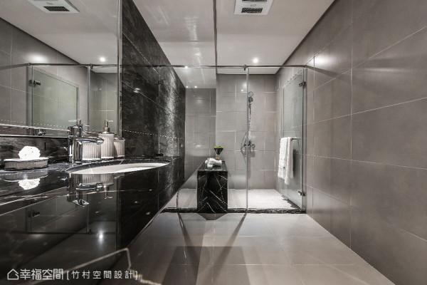 竹村空间设计利用深色调为基底,搭配镜面和自然材质的结合,创造出大器精致的沐浴氛围。
