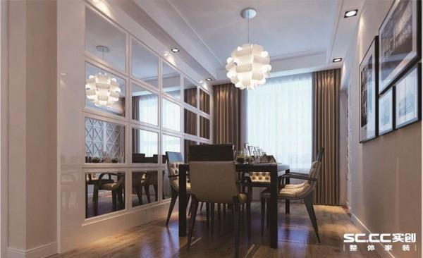 :本案的餐厅设计亮点便是银镜,以及吊顶。与客厅的设计合二为一,相互呼应。还运用两幅现代挂画,更符合现代人的审美品位。