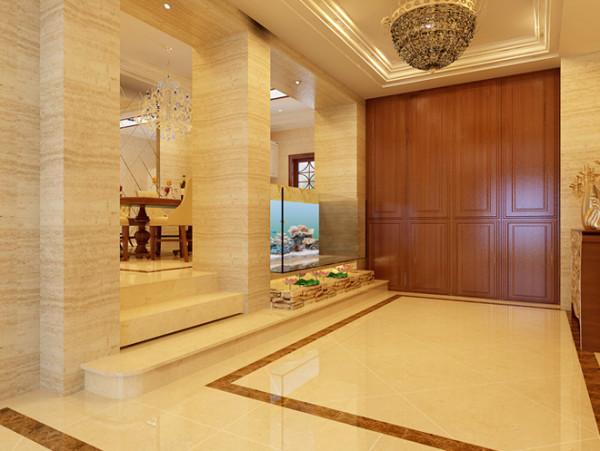 设计说明:柱形构造把空间分割成不同的功能区,门厅一盏蜂窝形吊灯打造灯光,清爽的大鱼缸修饰了整个门厅,也是一种吉祥富贵的象征。
