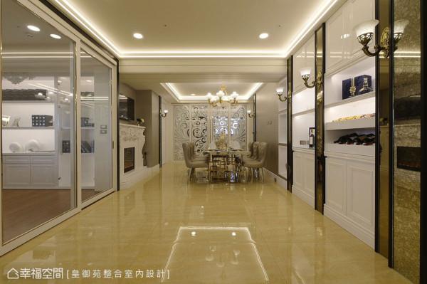 以雷射切割精准制成的厨房镂空夹玻隔屏,点缀纯铜灯架西班牙云石灯罩,让迈向餐厅的廊道飘逸浓浓欧式风味。