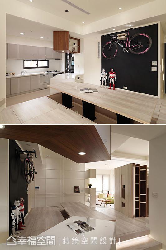 黑板漆壁面提供屋主两个小孩挥洒创意的角落,吧台和吊柜则运用特别的折角设计,进而与餐桌产生连结,创造出连绵延伸的视觉动线。