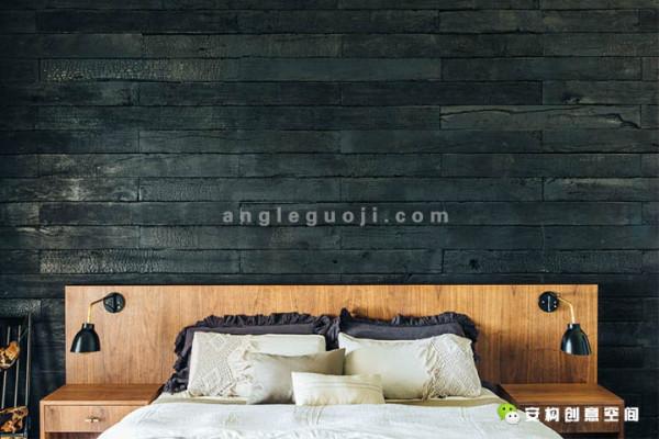 卧室的背景采用黑色石材拼接,给人一种高冷的感觉。