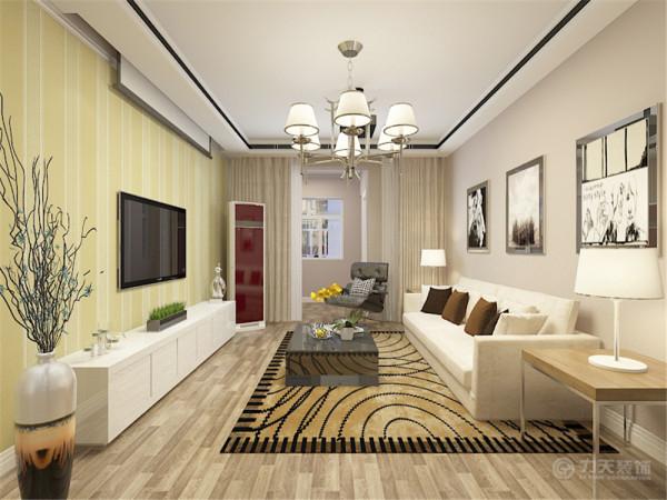 本次案例的设计风格是现代风格,通过前期和业主的沟通了解到客户还是十分喜欢现代风格的设计方案。首先客厅空间整体开阔明亮,地面整体铺设了中性色的复合地板,墙面是浅咖色的乳胶漆,顶面是典型的现代风格吊顶。