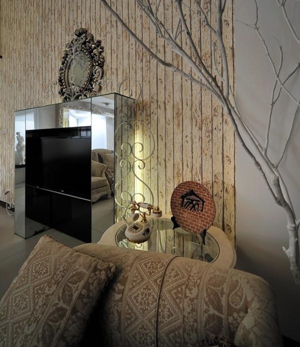 客厅一角,白色树枝是上山砍的,刷漆