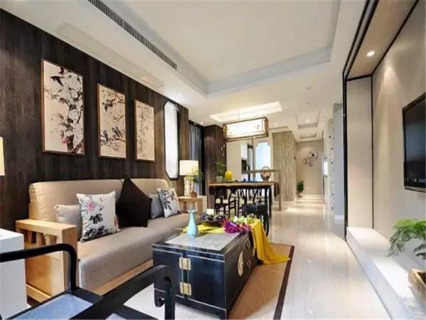 沙发背景用深灰色的地板上墙制作。