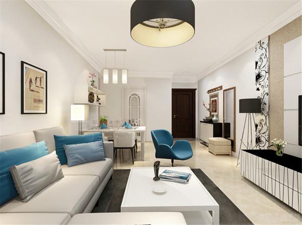 因为业主喜欢明亮的感觉,干净的感觉, 所以在客厅中主题使用了白色,在家具上使用了现代感较强的米白色家具,在搭配上使用了一些蓝色调,让整体看起来没有那么的平淡。