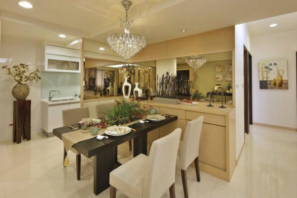 舍弃水泥墙隔间,设计师以茶镜L形延伸,界定餐厨空间,不减低空间感;紧邻的收纳柜以长远使用为考量,选用防刮易清洁的美耐板为素材。
