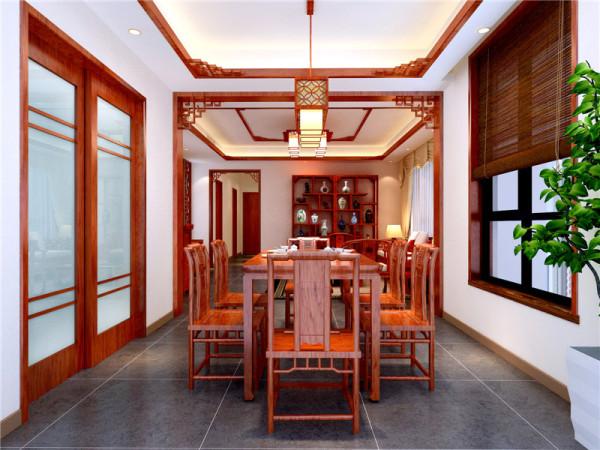 朱红色的餐桌椅,配上精致的灯饰,使整个空间硬朗而又华丽、优雅。餐厅的装修又是木质镂空隔断,大气经典。