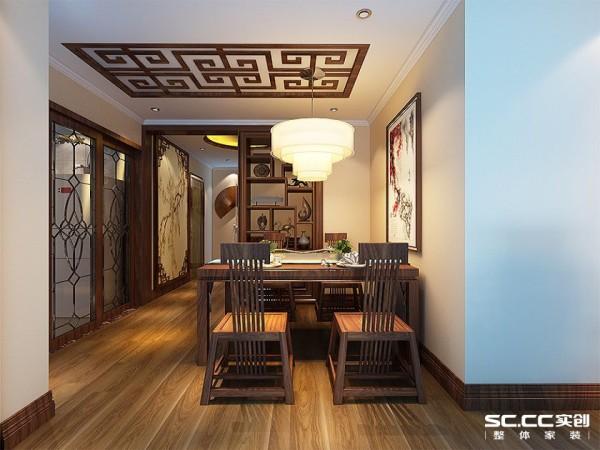 餐厅略具有禅意,特别设计的灯具与挂画作为亮光和点缀避免了空间的压抑感。