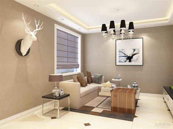 客厅用L型沙发为业主及家人提供舒适的居家环境,采用浅色硬包电视背景墙增添年轻气息及现代感,整体采用浅色壁纸的朴素大方来装饰墙面的景点。