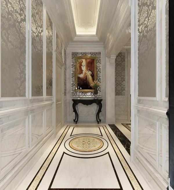 从造型吊顶到地面拼花石材以及两边的墙面装饰,兼以银白色为主,营造高贵典雅的气氛,一幅西方油画是空间的点睛之作,让人不容忽视。