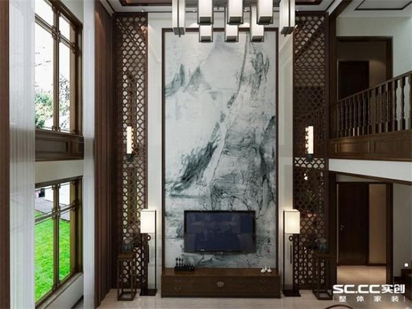 电视背景墙为一副泼墨山水画,两侧为中式花格,花格背后为镜子,配以对称的壁灯,提升空间质感,展现了空间的文化底蕴。