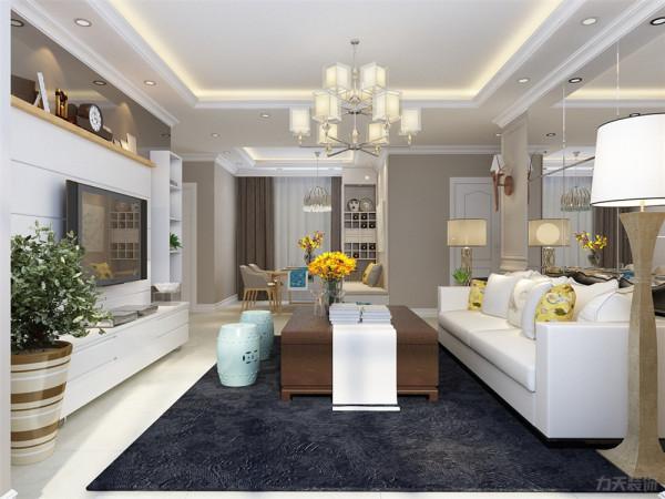 客厅的顶部采简约回字形吊顶,给整个空间营造一种纯洁之感,又不失造型感
