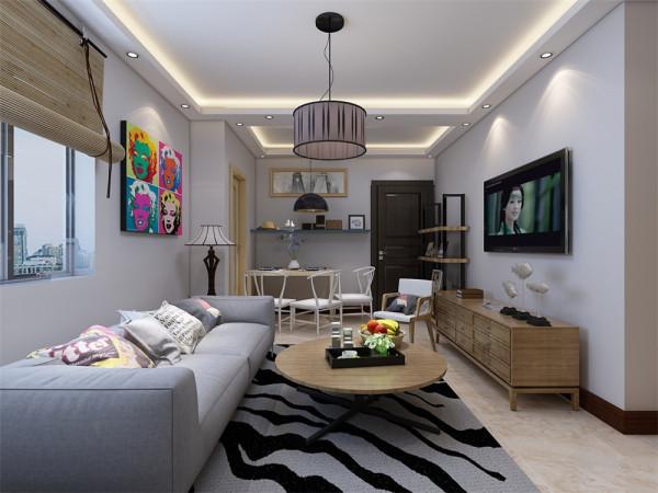 客厅设计讲究的是简约、稳重,深色的电视柜、浅色的茶几,沙发,餐桌使得整个空间即稳重又清新,布艺的沙发为空间增添温暖简洁干净的气息。