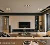 原境国际室内设计以带有自然纹理的木化石,来铺述电视墙的细腻表情。