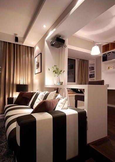 沙发背后的吧台设计自然而然就成为了业主们的工作台啦。