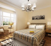在卧室的设计中,同样我们采用了木色的木地板,木色的衣柜配彩色条纹的双人床使偏冷色系的空间有了少许温暖和亲切,地板采用的是实木复合地板具有防滑的功效。