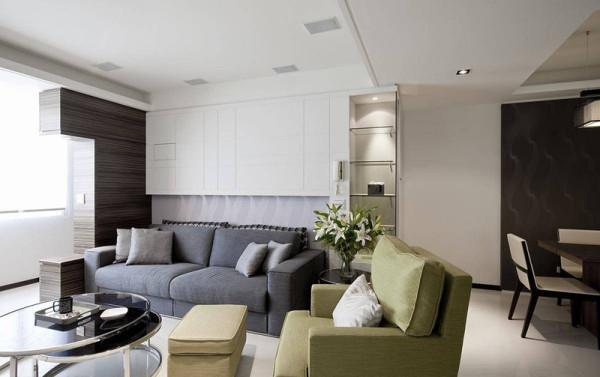 沙发墙以细腻切割线条装饰,让年轻玩味的设计,增添空间的趣味性。