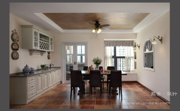 入户左侧是餐厅,这里有西式乡村风格厨柜,六人餐桌,空间宽敞明亮