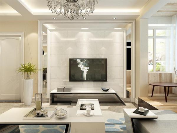 客厅与餐厅是整个在一个空间的格局。电视背景墙做了石膏线收边内加石材的设计,增添了整个空间设计性,沙发墙配合照片墙的装饰,增加现代感,沙发选用了灰色作为装饰。