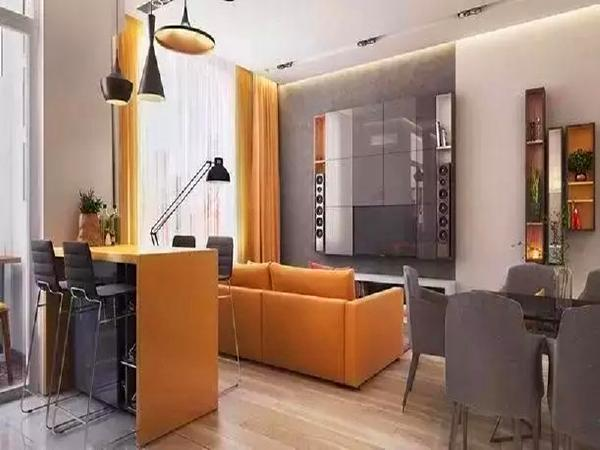 从窗帘、沙发到吧台无一例外都用了同色系的黄色,餐桌椅和移门运用了黑灰色,整个区域色彩既和谐统一又凸显出自己的个性。
