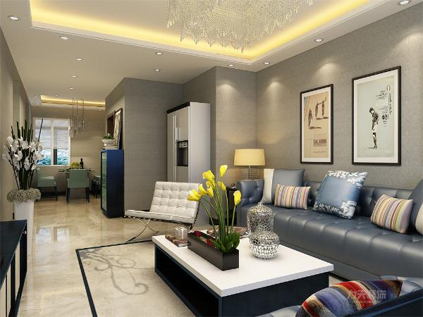 客厅采用回子型吊顶来增加空间光感。沙发选择了蓝色皮质的沙发,给人一种看着就想坐下的舒适感。