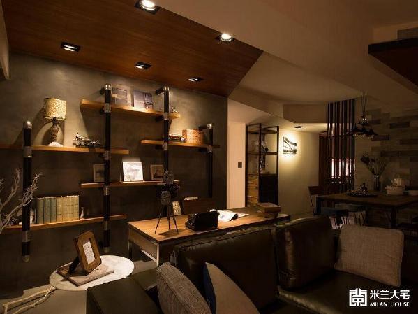延续地面转折而上的磐多磨壁材,让不锈钢管与柚木层板构成的装置书柜,自然成为空间一景