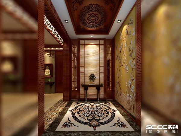 入门处玄关用镂空花雕做装饰,突出了本案的设计理念,是菊花的元素提取,地板是水墨色大理石拼花。客厅和餐厅则大量使用木材家具,以明清的特点最为特出,空间色彩以淡淡的琉璃黄为主。