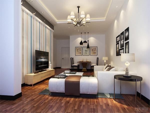 客厅采用回子型吊顶来体现空间的光感。沙发选用以白色为主的色调为整体空间提升了干净整洁舒适度,客厅墙面整体采用白色乳胶漆,地面采用的是强化复合地板。