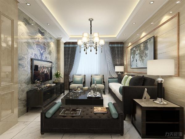 客厅的设计,采用了回字形吊顶,周边走了一圈的顶角线,电视背景墙采用了大理石的材质,墙面为壁纸,时尚感倍增。为整个增加了现代的质感,水晶的吊灯,为空间点染了些许的大气与舒适的个性。
