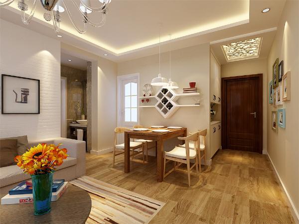 传统吊灯与角线的运用给整体增加了稳重丰富的空间体验。将释放的空间设计为餐厅,同时也增加了自然采光。业主希望有明亮的色彩整体温馨舒适。