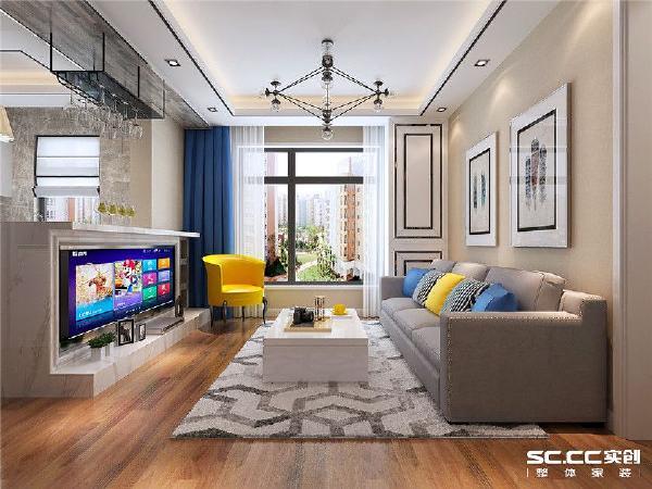 因为整个房屋面积较小,为了将原本小的空间做大,设计上采用半开放式将客厅和厨房打通,电视墙和吧台做成一体,既满足年亲人需要吧台的需求又使空间变得通透,简单的顶棚直线造型增加了空间的层次感。