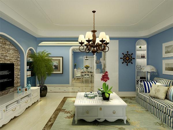 客厅空间讲究沉稳大方,整体为淡蓝色乳胶漆,突出海洋气息,蓝白相间但是造型不复杂的家具使整个空间复函一种怀旧的地中海气息,