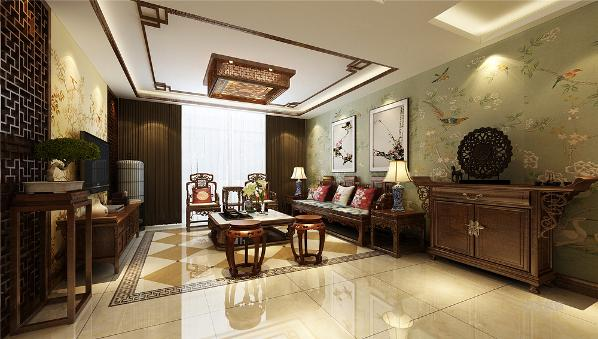 一进入户门左侧便是客厅的位置厅的设计只是做了简单的处理,沙发背景墙采用的是十分浓烈的中国画并配有壁纸,简单朴素,格调高雅。