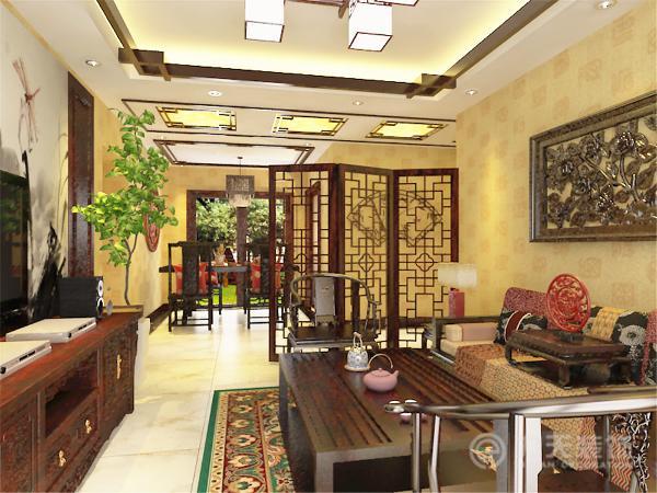 为了区分客厅和过道的空间,我特意加放了一道中国传统的木质格栅屏风,虽然在空间上隔绝了两个空间,但是从视觉上能透过视线,这样就不会觉得空间狭隘。