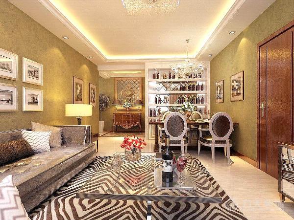 客厅采用回形顶加石膏线装饰,起到软化线条的作用,突出层次。玄关采用椭圆形吊顶,增加空间造型感。墙面采用暖色乳胶漆,营造温馨柔和的感觉。