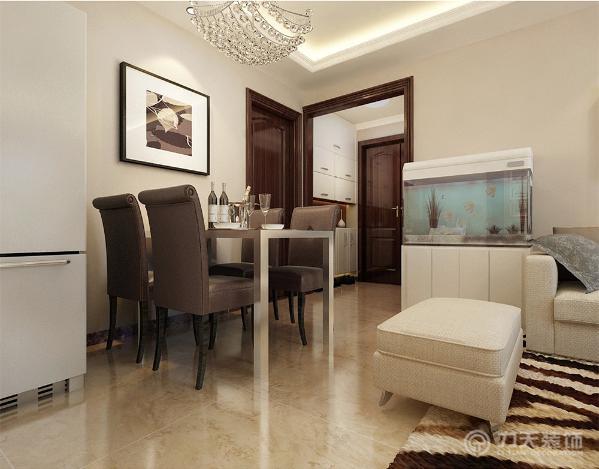 深色的餐椅餐桌增加空间色调对比度,使空间更加清晰色调更加丰富,营造出温馨舒适的感觉,沙发旁边还放置了鱼缸,让空间添加一丝自然的气息。