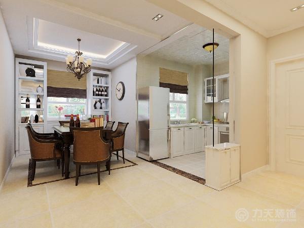 客餐厅的沙发和餐桌等家具选用了深色调的木色系,但整体墙面采用了浅色调,这样不会显得很沉闷,客厅的吊顶做成了九宫格的形式,很好的区分了空间,并且带有很强的装饰性。
