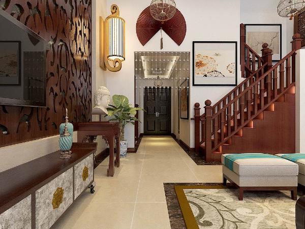 在入户门玄关的设计,玄关采用回行吊顶,放置一个鞋柜一盏竹制的吊灯,用珠帘把玄关和客厅进行分开。