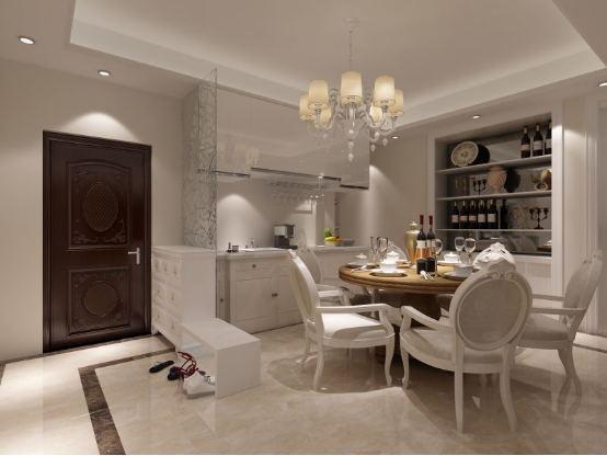 餐厅是一家人最温馨的聚餐空间。橱柜在设计上采用简洁的造型,配以洁白的色调、整体在淡黄的灯光下衬得愈加温馨。
