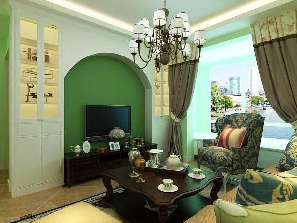 电视背景墙刷了墨绿色乳胶漆,在两边做了整体柜子,可以增加存储功能