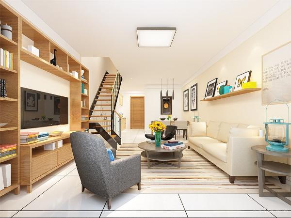 客厅的背景墙做成了书架的形式,在中间镂空的地方设置了电视的区域,整个造型美观又非常具有实用功能再加上业主喜欢木色与白色的搭配的色调。