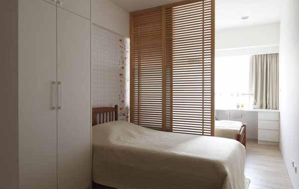 简约 三居 卧室图片来自上海潮心装潢设计有限公司在116平装修简约设计增添空间表情的分享